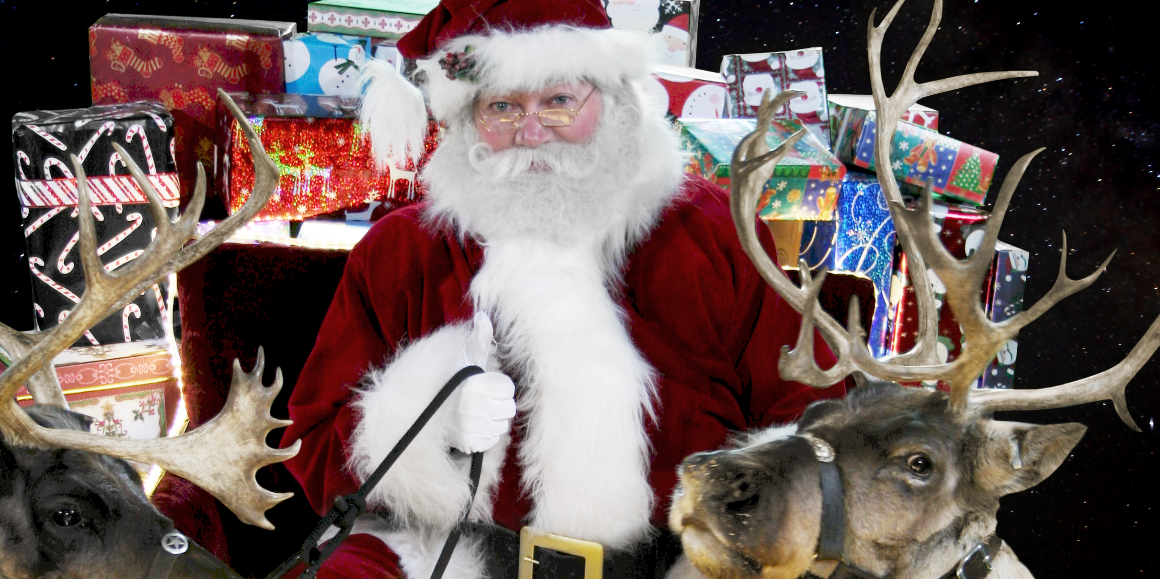 Santa and reindeer delivering presents from the elves
