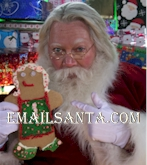 Santa with gingerbread cookie. Santa loves Christmas cookies too!
